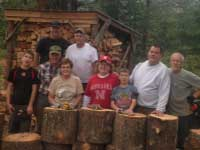 Volunteers Cutting Wood for Marble Retreat